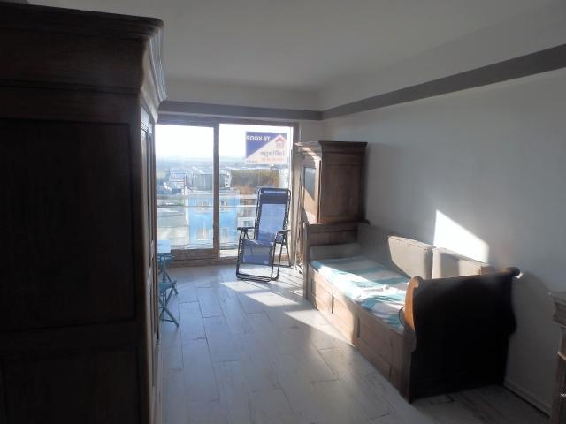 Zongerichte studio met zonneterras
